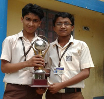 Girija-Prasanna-Pradhan-and-Abhinav-Raj-of-Std.-VIII-receiving-the-runners-up-trophy-in-the-Sub-Divisional-Science-Exhibition.
