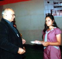 Ms.-Sharmistha-Prasad-receiving–a-Cash-award-for–being-the-2nd-topper-for-ICSE-Examination-2011.